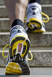 Athlete running stairs Stock Photo
