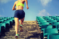 Athlete running on stairs. Runner athlete running on stairs. woman fitness jogging workout wellness concept stock photo
