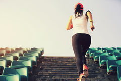 athlete running on stairs. woman fitness jogging workout wellness concept. Stock Photography