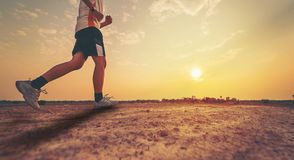 Athlete running with sunrise or sunset. Background Royalty Free Stock Images