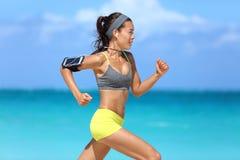 Athlete running woman runner listening to music stock photo