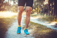 Athlete running through the woods. Royalty Free Stock Photo