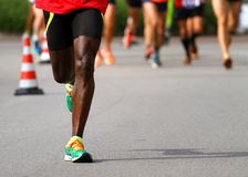 Athlete runs down the street during the race outdoors Royalty Free Stock Photography