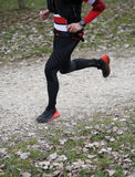 Athlete runs fast with long strides during the triathlon race wi. Th black sportswear royalty free stock photo