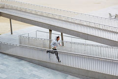 Athlete runs a small bridge Stock Images