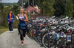 UKRAINE, LVIV - SEPTEMBER 2018: The athlete runs in the transit area after sailing to the bike during the triathlon competition stock photography