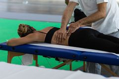 Athlete`s Back Massage after Fitness Activity; Wellness and Sport