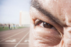 Athlete's eye with angry expression, close-up Royalty Free Stock Photo