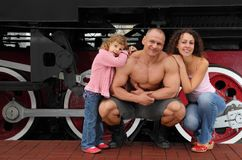 Athlete`s family against  locomotive Stock Photography