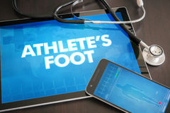 Athlete's foot (infectious disease) diagnosis medical concept. On tablet screen with stethoscope Stock Photo