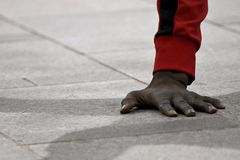 The athlete`s hand during the performans stock photography