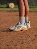 Athlete's Legs. A side view of a sporty boy's legs with shoes and socks Stock Images