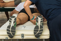 Athlete's Muscles Massage after Sport Workout Stock Image