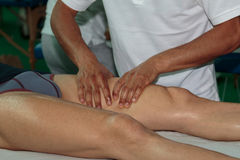 Athlete`s Muscles Massage after Sport Workout Stock Image