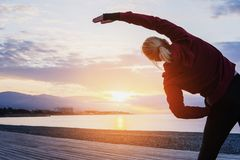 Athlete on the seacoast. Exercise, workout and healthy lifestyle Stock Image
