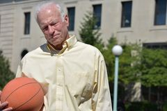 Athlete Senior Male Basketball Coach And Depression. A retired senior adult male stock images