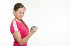 Athlete shakes muscles of the hand expanders Stock Photo