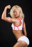 Athlete showing her biceps Royalty Free Stock Images