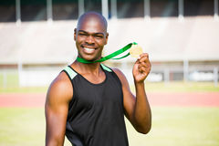 Athlete showing his gold medal Stock Image