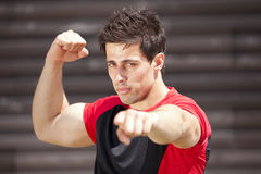 Athlete showing his muscles Royalty Free Stock Photography