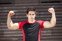 Athlete showing his muscles Stock Photography