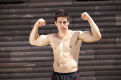 Athlete showing his muscles Royalty Free Stock Image