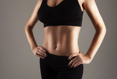 Athlete showing perfect slim stomach Stock Photos