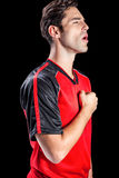 Athlete showing respect during national anthem. On black background Royalty Free Stock Images