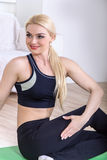 Athlete shows her body in sportswear Royalty Free Stock Photography