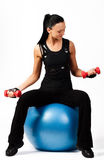 Athlete sitting on fitness ball with weights Royalty Free Stock Photo