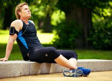 Athlete Sitting and Listening to Music Stock Photo