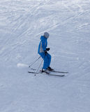 Athlete skiing in the snowy mountains Stock Images