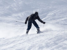 Athlete skiing in the snowy mountains Royalty Free Stock Photo