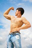 Athlete on sky background Royalty Free Stock Images
