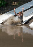 Athlete slides into mud Royalty Free Stock Images