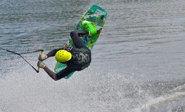 The athlete with snowboard hold on to the rope and the boat accelerates. Russia, Volgodonsk - June 18, 2015: Water snowboard. The athlete with snowboard hold on Stock Images