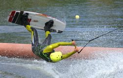The athlete with snowboard hold on to the rope and the boat accelerates. Russia, Volgodonsk - June 18, 2015: Water snowboard. The athlete with snowboard hold on Stock Image
