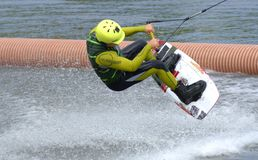 The athlete with snowboard hold on to the rope and the boat accelerates. Russia, Volgodonsk - June 18, 2015: Water snowboard. The athlete with snowboard hold on Stock Photo