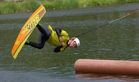 The athlete with snowboard hold on to the rope and the boat accelerates. Russia, Volgodonsk - June 18, 2015: Water snowboard. The athlete with snowboard hold on Stock Photography