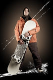 Athlete snowboarder. The guy with snowboard in the hands Stock Image