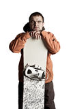 Athlete snowboarder. The guy with snowboard in the hands Stock Photos