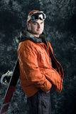 Athlete snowboarder. The guy with snowboard in the hands Royalty Free Stock Images