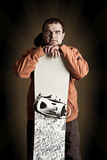 Athlete snowboarder. The guy with snowboard in the hands Royalty Free Stock Photography