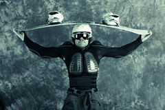 Athlete snowboarder. The guy with snowboard in the hands Stock Images