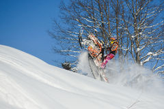 Athlete on a snowmobile moving  in the mountains. SAKHALIN RUSSIAN - JANUARY 23 : Oleg Bibikov moving snowmobile in winter forest in the mountains of Sakhalin Stock Photos