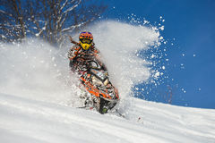 Athlete on a snowmobile moving  in the mountains. SAKHALIN RUSSIAN - JANUARY 23 : Oleg Bibikov moving snowmobile in winter forest in the mountains of Sakhalin Stock Photo