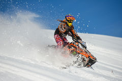 Athlete on a snowmobile moving  in the mountains. SAKHALIN RUSSIAN - JANUARY 23 : Oleg Bibikov moving snowmobile in winter forest in the mountains of Sakhalin Stock Image