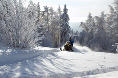 Athlete on a snowmobile Stock Images