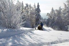 Athlete on a snowmobile Stock Photo