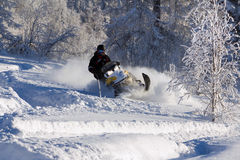 Athlete on a snowmobile. Royalty Free Stock Images